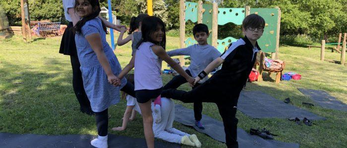 Childrens yoga teacher training partner poses