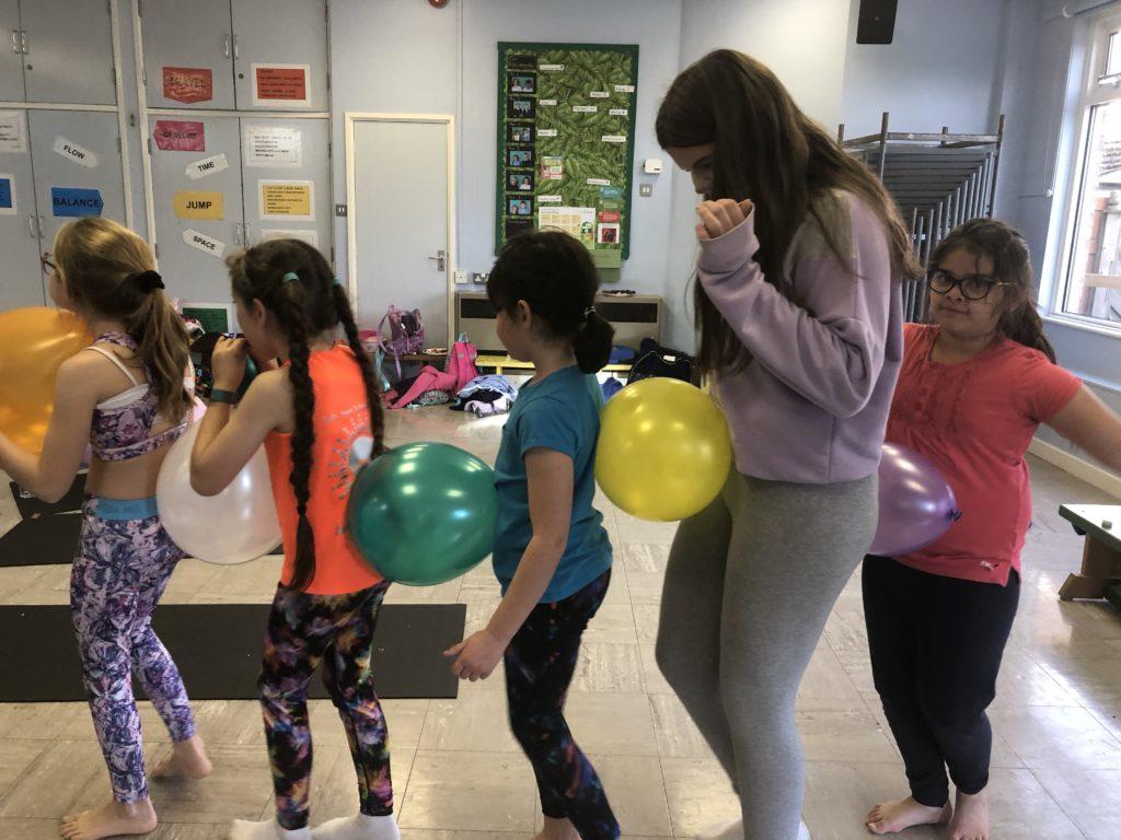 Children's yoga balloon game